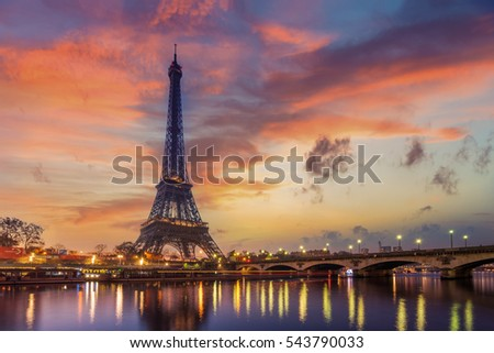 The Eiffel tower at sunrise in Paris France #543790033