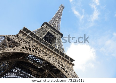 The Eiffel Tower in Paris shot against a blue sky - stock photo