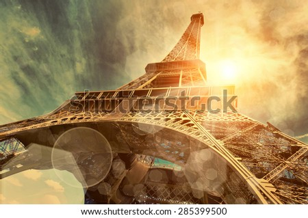 The Eiffel tower is one of the most recognizable landmarks in the world under sun light #285399500