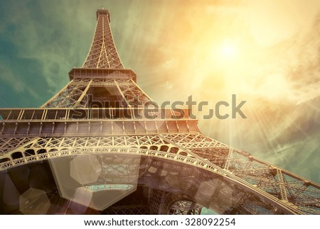 The Eiffel tower is one of the most recognizable landmarks in the world under sun light #328092254