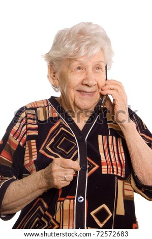 The elderly woman speaks on the phone - stock photo