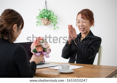 The elderly woman who does a business meeting