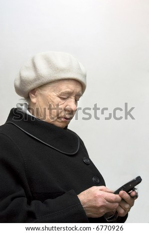 The elderly woman with mobile phone