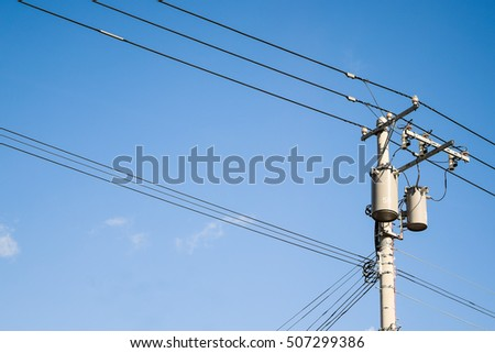 The electric pole and electric transformer with clear blue sky