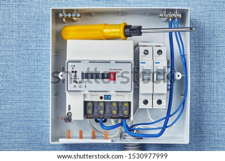 The electrical panel, electric meter and circuit breakers. Distribution board with single phase energy meters. The fuse board has switches that branch the electricity to each appliance inside home.