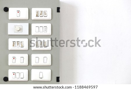 The electricity control panel on the wall. #1188469597