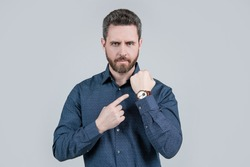 The elegance of punctuality. Bearded man point at wristwatch. Punctuality concept. Business time. Deadline. Timekeeping. Accurate time, accurate watch.