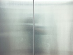The elevator door made from stainless steel with color tone for background or texture.