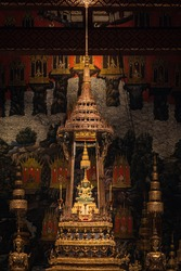 The Emerald Buddha in Wat Phra Kaew temple at Bangkok, Thailand. The most famous Buddha statue and travel destination for worship in Thailand. Tourism Concept.