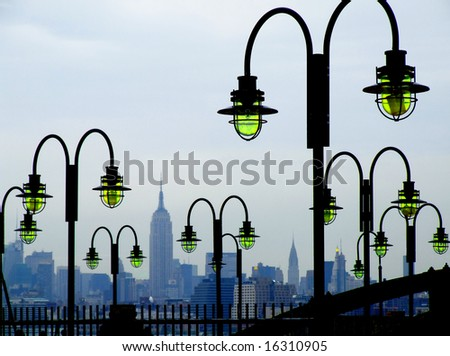 The Empire State Building in New York City as seen from the New Jersey side. Ferry Pier to Liberty and Ellis Islands