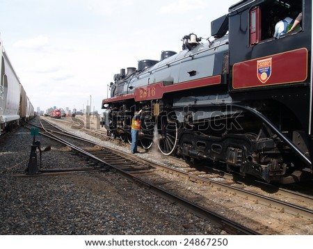 The Empress, a 1930 Hudson, 4-6-4 Hudson steam locomotive is serviced while awaiting entry to the Strathcona Rail Yard, Edmonton, Alberta, Canada
