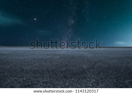 The empty highway under the starry night sky