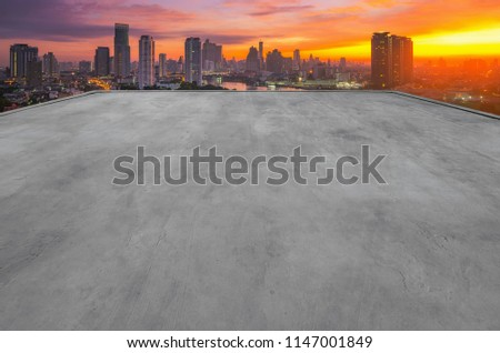 The empty rooftop of the building is perfect for showcasing with modern cityscape background. #1147001849
