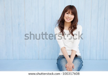 The empty space in the blue background of Asian women and fluttering hair - stock photo