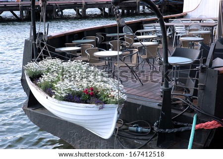 The Empty street cafe on boat and little boat with flower