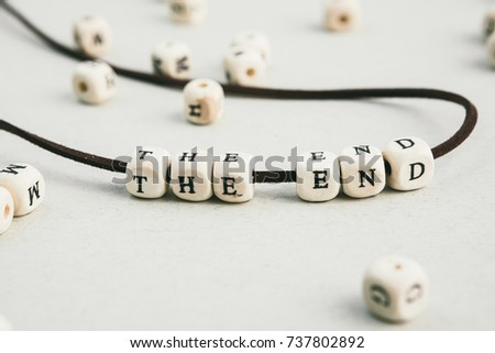 The end. phrase made of  wooden beads letters.  Horizontal composition. a series of conceptual phrases and words. #737802892