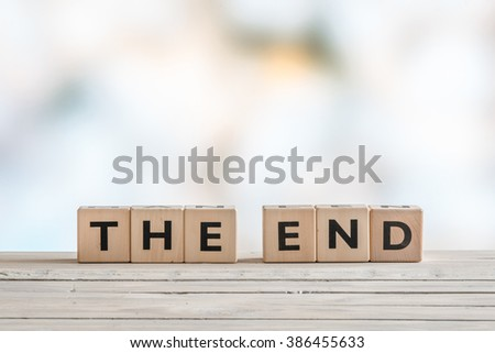 The end sign with wooden blocks on a table #386455633