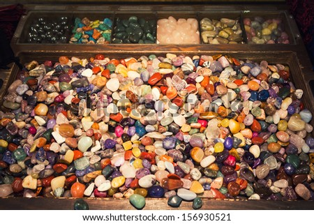 The energy of a box full of colorful mixed gemstones
