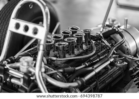 The engine bay of a vintage race car.