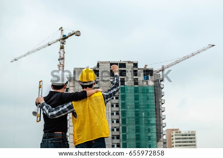 The engineer holds up a happy hand. With achievements in the construction area.