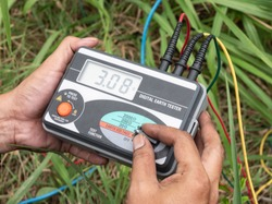 The engineer is using digital earth tester for measure insulation resistance between the electrical part with grounding or earth to protect short circuits.