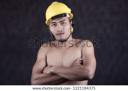 The engineer wears a yellow helmet. But do not wear a shirt.People wearing construction helmets  #1221184375