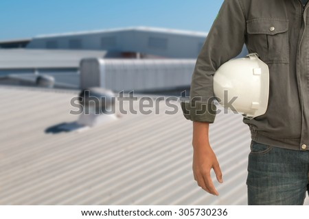 The engineering and safety helmets stood on the details of architectural metal roofing in commercial construction.
