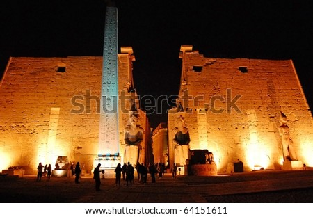 The entrance of Luxor Temple in lights at night.