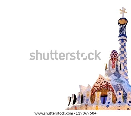 The entrance of  Park Guell in Barcelona with the famous mosaics of Antonio  Gaudi isolated on white