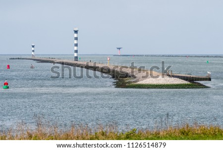 The entrance of the Port of Rotterdam in the Netherlands with dams and lighthouses,  seen from the Landtong near Rozenburg. Stockfoto ©