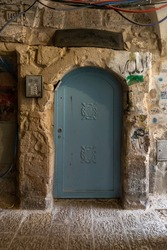The entrance to a residential building in the Muslim Quarter near the exit from the Temple Mount - Chain Gate, in the old city of Jerusalem, in Israel