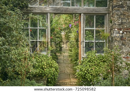 The entrance to an old Victorian greenhouse with cobbled path                         Сток-фото ©