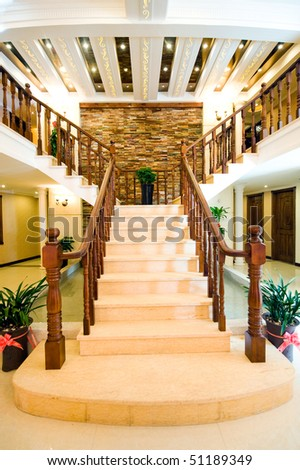 The entrance to this beautiful house, the spiral stair case. - stock photo
