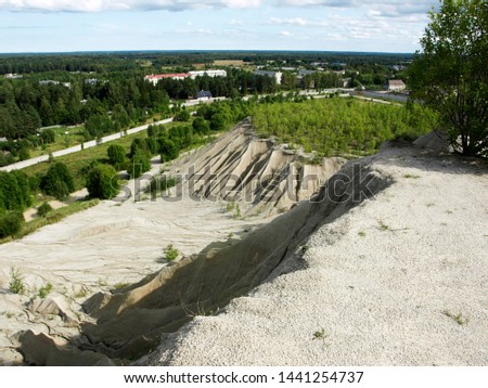 The erosion from the quarry in the limestone quarry ,view of abandoned prison located in small lake with blue clear water in Rummu, Estonia #1441254737