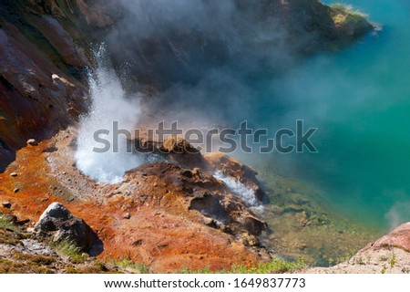 """Photo of  The eruption of a geyser in """"Valley of geysers"""", Kamchatka."""