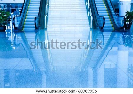 the escalators and inverted reflection toned in blue color.