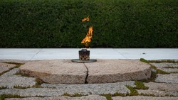 The Eternal Flame at John F. Kennedy's grave in Arlington National Cemetery on August 17, 2019.
