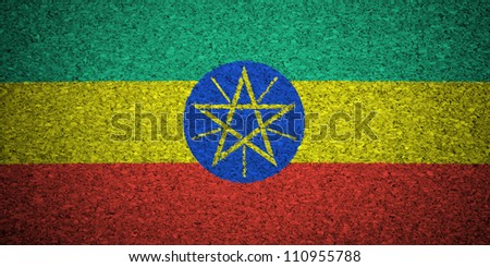 The Ethiopia flag painted on a cork board.