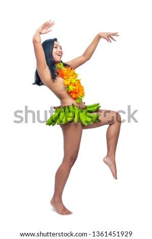 The ethnic woman in banana skirt dancing savage dances, isolated on white background. Wildly show of exotic performance, Exotic female dancer make ritual dance. #1361451929