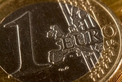 The European money. Coin with a face value of 1 euro. The currency of Europe. Close-up, Macro photography.