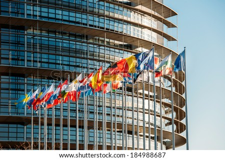 The European Parliament building in Strasbourg, France with flags waving on a spring evening
