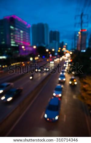 The evening twilight traffic in Bangkok city lights motion blur #310714346