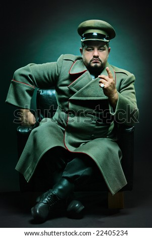 The evil dictator sitting in a chair