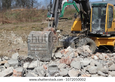 The excavator loads the load on the car. Construction works. Technology of urbanization. Heavy industrial machines. Building of the city. Mechanization of heavy manual labor. Modern technologies. #1072050002