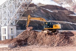 The excavators (hydraulic) excavation on the pile of soil. Excavators are also called diggers, JCBs, mechanical shovels, or 360 degree excavators. Tracked excavators are sometimes called trackhoes.