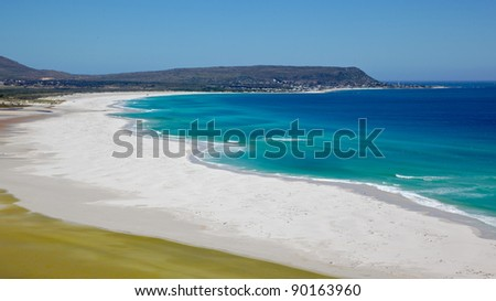 The expanse of Long Beach, with Kommetjie in the background, Cape Peninsula, Cape Town, South Africa.