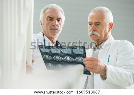 the experienced doctors discussing x-rays