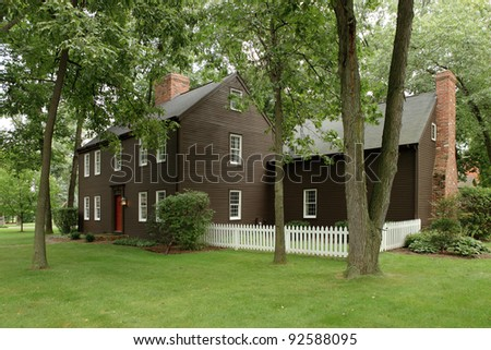 The exterior of an 18th century reproduction primitive for Reproduction homes