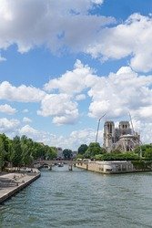 The exterior of Notre Dame church, with scaffolding to support the repair work being undertaken after it was badly burned in a fire. Image has copy space.
