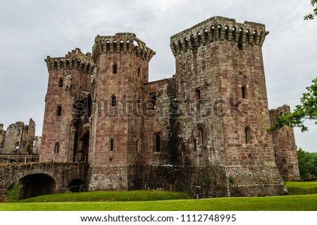 The exterior walls of a ruined medieval castle (Raglan Castle)